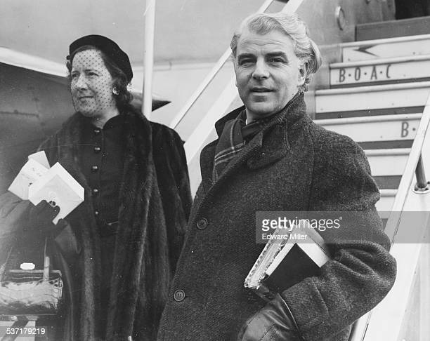 Actor Emlyn Williams and his wife Molly arriving at London Airport March 17th 1952