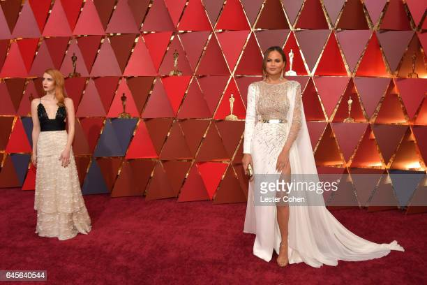 Actor Emma Roberts and model Chrissy Teigen attend the 89th Annual Academy Awards at Hollywood Highland Center on February 26 2017 in Hollywood...