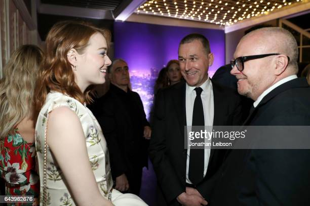 Actor Emma Stone chief executive office Barneys Mark Lee and Ed Filipowski attend Vanity Fair and Barneys New York Private Dinner in Celebration of...