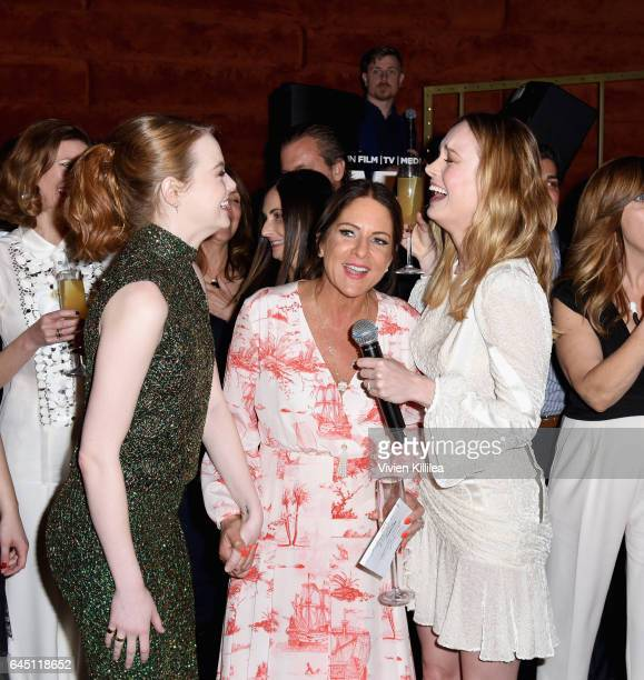 Actor Emma Stone President of Women In Film Cathy Schulman and actor Brie Larson attend the tenth annual Women in Film PreOscar Cocktail Party...