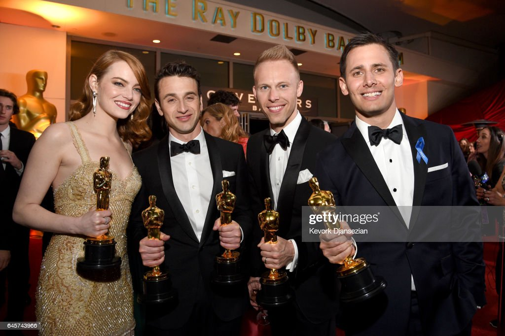 Actor Emma Stone, winner of the award for Actress in a Leading Role for 'La La Land,' and composers Justin Hurwitz, Justin Paul and Benj Pasek, winners of the award for Music (Original Song) for 'City of Stars' from 'La La Land,' attend the 89th Annual Academy Awards Governors Ball at Hollywood & Highland Center on February 26, 2017 in Hollywood, California.