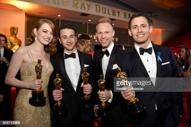 Actor Emma Stone winner of the award for Actress in a Leading Role for 'La La Land' and composers Justin Hurwitz Justin Paul and Benj Pasek winners...