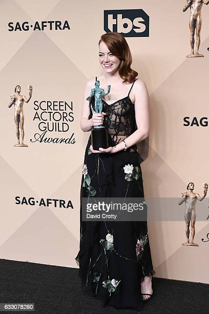 Actor Emma Stone, winner of the Outstanding Performance by a Female Actor in a Leading Role award for 'La La Land', poses in the press room at the...