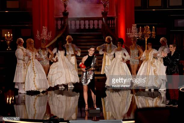 Actor Emma Watson accepts Best Actor in a Movie for 'Beauty and the Beast' onstage during the 2017 MTV Movie And TV Awards at The Shrine Auditorium...