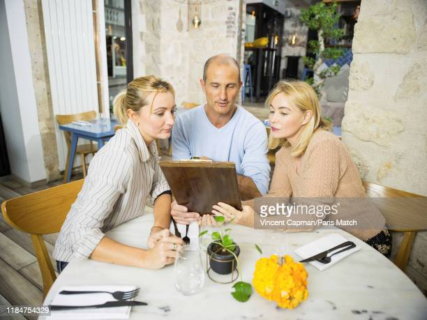 Actor Emmanuelle Beart with her brother Ivan Cerieix and her sister Sarah Cerieix who run the restaurant Les Petits Cousins in Montmartres are...