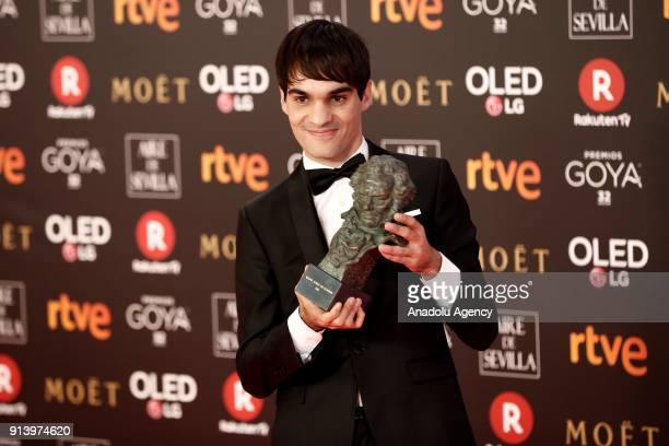 Actor Eneko Sagardoy poses with his award with the movie 'Handia' during the 32th edition of the Goya Awards ceremony in Madrid Spain on February 04...