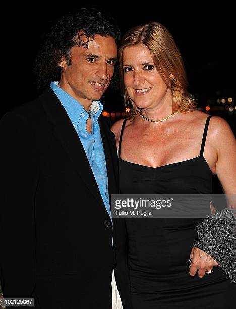 Actor Enrico Lo Verso and his wife attend a party at The Lancia Cafe on June 15 2010 in Taormina Italy