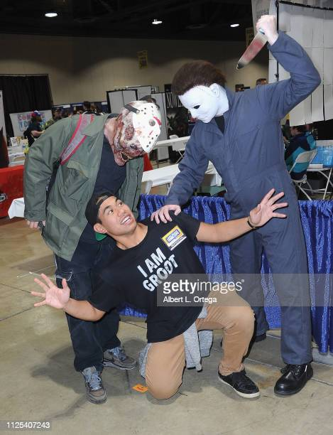 Actor Epati Scanlan poses with Jason Voorhees and Michael Myers at the 2019 Long Beach Comic Expo held at Long Beach Convention Center on February 16...