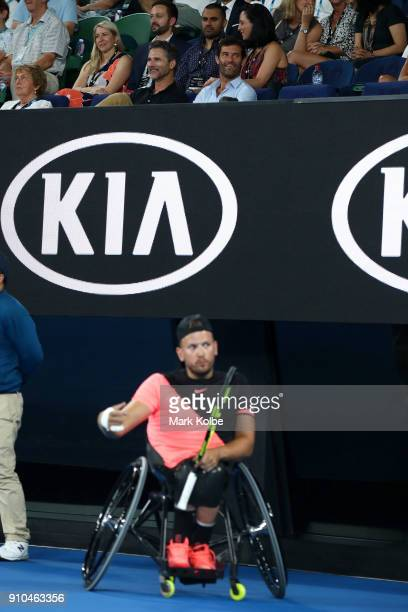 Actor Eric Bana and former Formula 1 driver Mark Webber watch the Quad Wheelchair Singles 3rd round match between Dylan Alcott of Australia and Heath...
