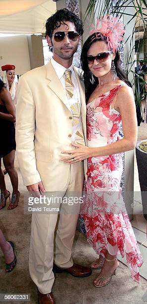 Actor Eric Bana and Rebecca Gleeson pose during the 2005 Crown Oaks Day at Flemington November 3 2005 in Melbourne Australia
