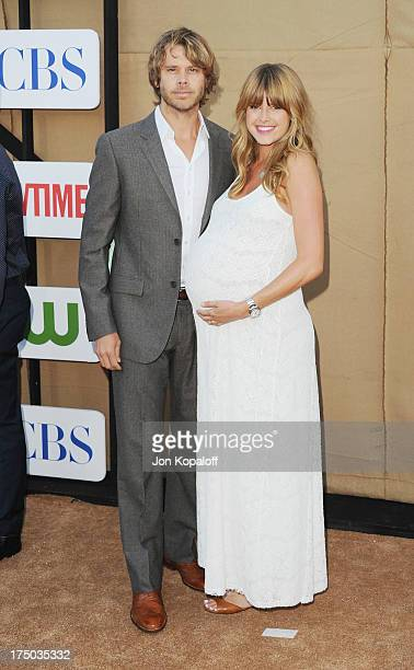 Actor Eric Christian Olsen and actress Sarah Wright arrive at the 2013 Television Critic Association's Summer Press Tour CBS The CW Showtime Party at...