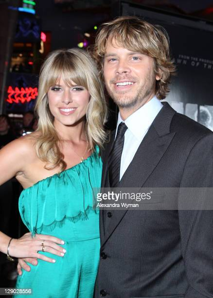 Actor Eric Christian Olsen and Sarah Wright arrive at The Thing Los Angeles Premiere held at The AMC Universal City Walk on October 10 2011 in...