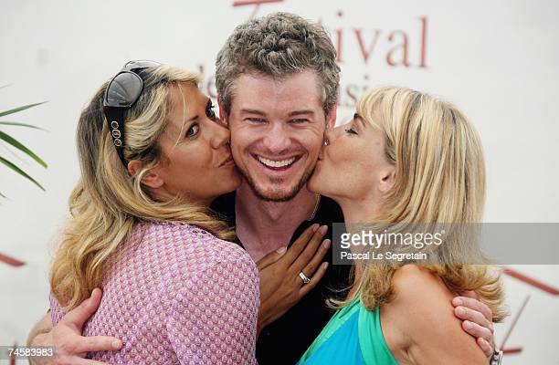 Actor Eric Dane shares a kiss with TV presenter Rachel Bourlier and actress Nathalie Vincent during a photocall promoting the television serie...