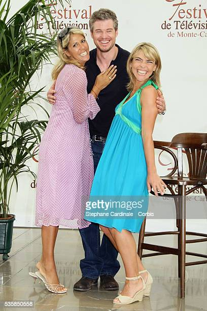 Actor Eric Dane snuggles up with TV presenter Rachel Bourlier and actress Nathalie Vincent during a photo call promoting the television series Grey's...