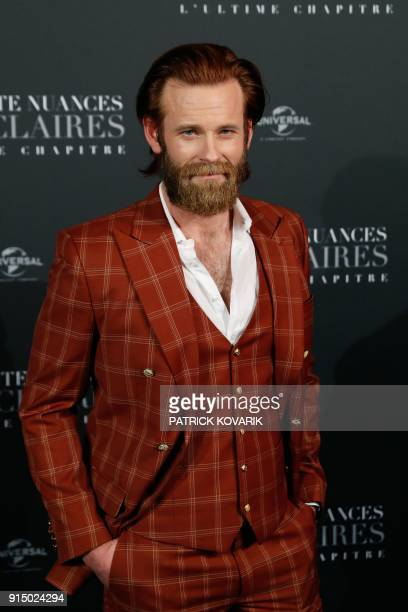 Actor Eric Johnson poses as he arrives to attend 'Fifty Shades Freed 50 Nuances Plus Claires' Premiere at Salle Pleyel in Paris on February 6 2018 /...