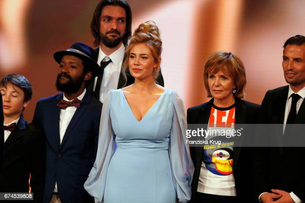 Actor Eric Kabongo actress Palina Rojinski and actress Senta Berger on stage with other cqst and crew during the award for Largest Audience for the...