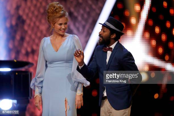 Actor Eric Kabongo and actress Palina Rojinski on stage at the Lola German Film Award show at Messe Berlin on April 28 2017 in Berlin Germany