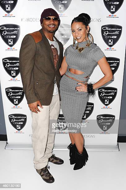 Actor Eric King and singer Soulfia attend the Grand Opening of West Coast Customs Burbank Headquarters at West Coast Customs on December 7 2014 in...