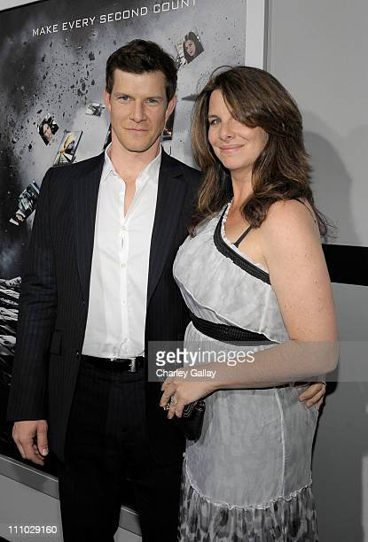 Actor Eric Mabius and Ivy Sherman arrive at the premiere of Summit Entertainment's Source Code at ArcLight Cinemas on March 28 2011 in Los Angeles...
