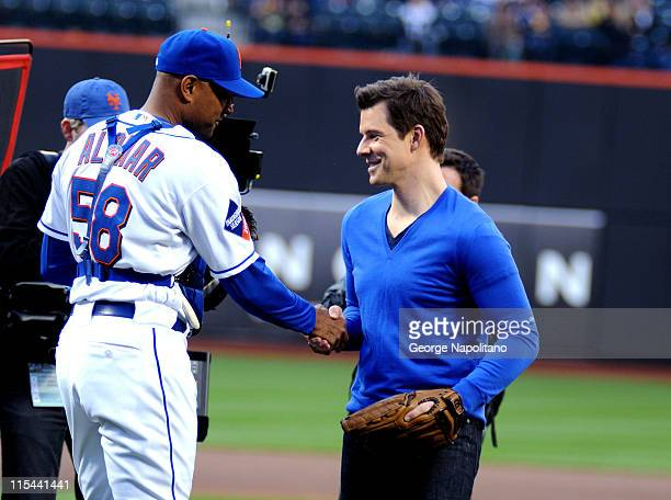 Actor Eric Mabius shakes hands with New York Mets coach Sandy Alomar Jr prior to the New York Mets game at Citi Field on April 24 2009 in New York...