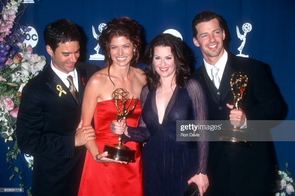Actor Eric McCormack, actress Debra Messing, actress Megan Mullally, and actor Sean Hayes from 'Will & Grace' attend the 52nd Annual Primetime Emmy Awards on September 10, 2000 at the Shrine Auditorium in Los Angeles. Will & Grace won the award for Outstanding Comedy Series, Hayes won for Supporting Actor, and Mullally won for Outstanding Supporting Actress in a Comedy Series.