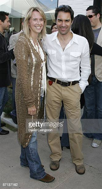 Actor Eric McCormack and his wife Janet Holden attend the John Varvatos 4th Annual Stuart House Benefit at the John Varvatos Boutique on March 19...