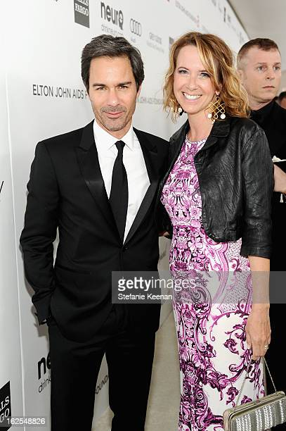 Actor Eric McCormack and Janet Holden attend Chopard at 21st Annual Elton John AIDS Foundation Academy Awards Viewing Party at West Hollywood Park on...