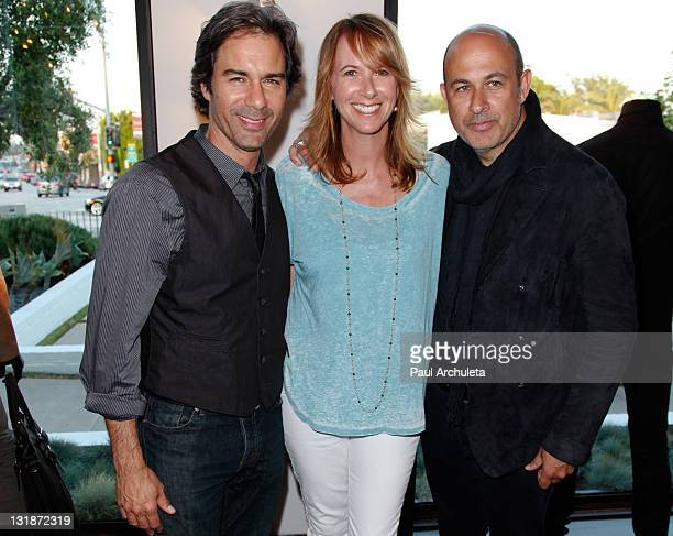 Actor Eric McCormack his wife Janet Holden and John Varvatos attend the Taken By Storm Opening Art Reception at John Varvatos Los Angeles on May 5...