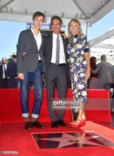 Actor Eric McCormack poses with his wife and son on his Hollywood Walk of Fame Star during a ceremony in Hollywood California on September 13 where...