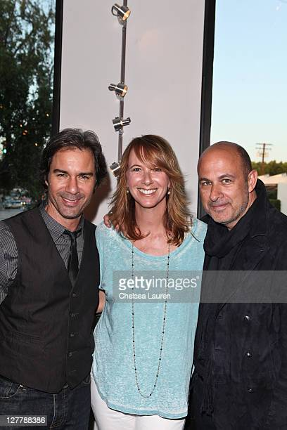 Actor Eric McCormack wife Janet Holden and designer John Varvatos attend the Storm Thorgerson Exhibit TAKEN BY STORM at John Varvatos Los Angeles on...