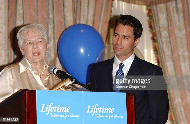 Actor Eric McCormack's mother Doris McCormack speaks while Eric looks on at the Lifetime Television Breast Cancer Heroes Luncheon at the Four Seasons...