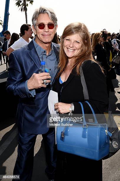 Actor Eric Roberts and Eliza Roberts pose with FIJI Water during the 30th Annual Film Independent Spirit Awards at Santa Monica Beach on February 21...