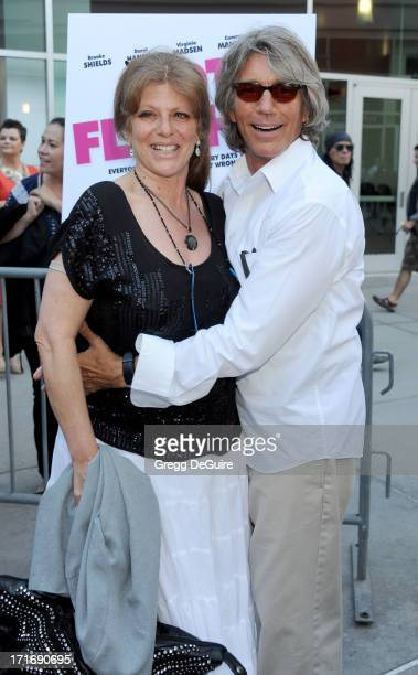 Actor Eric Roberts and wife Eliza Roberts arrive at the Los Angeles premiere of 'The Hot Flashes' at ArcLight Cinemas on June 27 2013 in Hollywood...