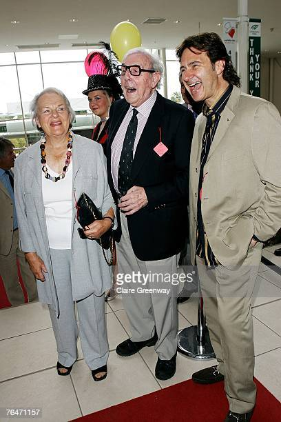 Actor Eric Sykes his wife Edith and Chief Barker of the Variety Club Russ Kane attend the 49th Variety Club Race Day at Sandown race course on...