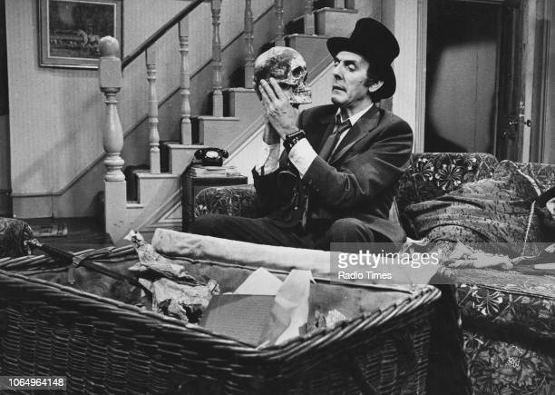 Actor Eric Sykes holding a skull in a scene from episode 'Haunting' of the television sitcom 'Sykes' November 15th 1973