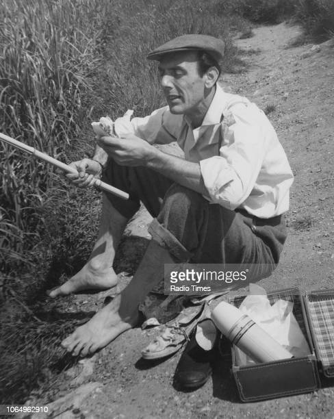 Actor Eric Sykes sitting on a riverbank in a scene from episode 'Fishing' of the television sitcom 'Sykes' May 31st 1960