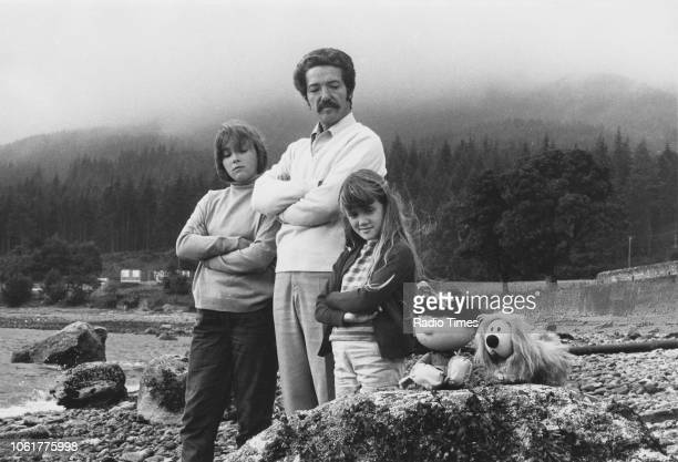 Actor Eric Thompson narrator of the children's television series 'The Magic Roundabout' pictured with his daughters Emma and Sophie and the puppets...