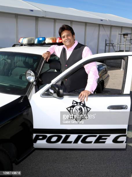 Actor Erik Estrada poses with a Police Chase Las Vegas police car at the grand opening of Police Chase Las Vegas on January 19 2019 in Las Vegas...