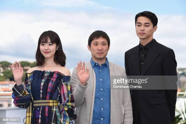 Actor Erika Karata director Ryusuke Hamaguchi and actor Masahiro Higashide attend the photocall for the Asako I II during the 71st annual Cannes Film...