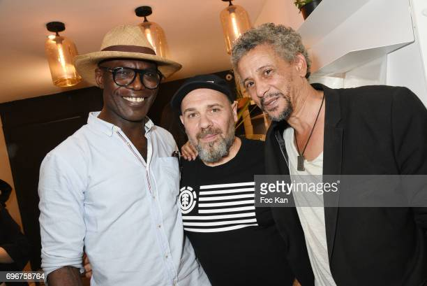 Actor Eriq Ebouaney director/painter Olivier Megaton and actor Abel Jafri attend Olivier Megaton Exhibition Preview at Upper Concept Store Gallery on...