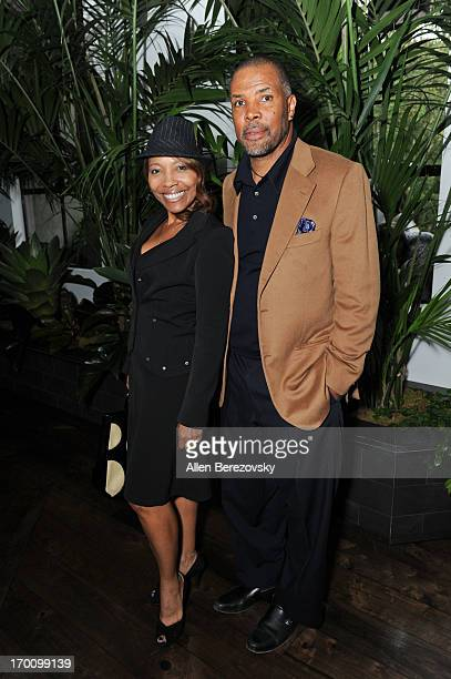 Actor Eriq La Salle and a guest attend Jeremy Renner's and Kristoffer Winters' celebration of the launch of Robb Report Home Style on June 6 2013 in...