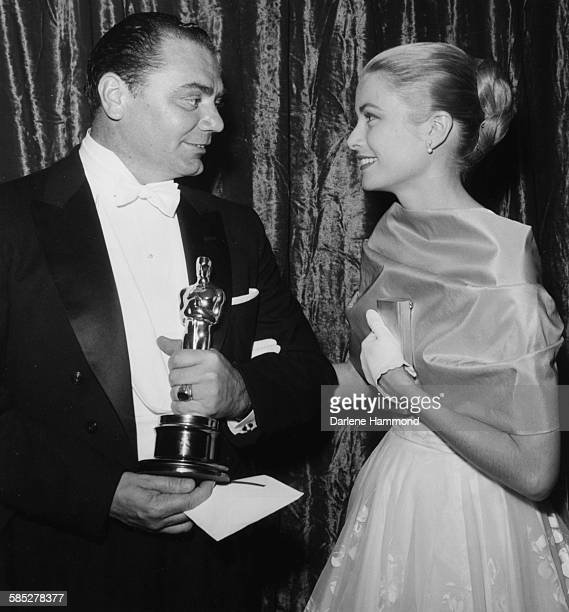 Actor Ernest Borgnine holding his Best Actor Oscar for the film 'Marty' with presenter Grace Kelly at the 28th Academy Awards Los Angeles March 21st...