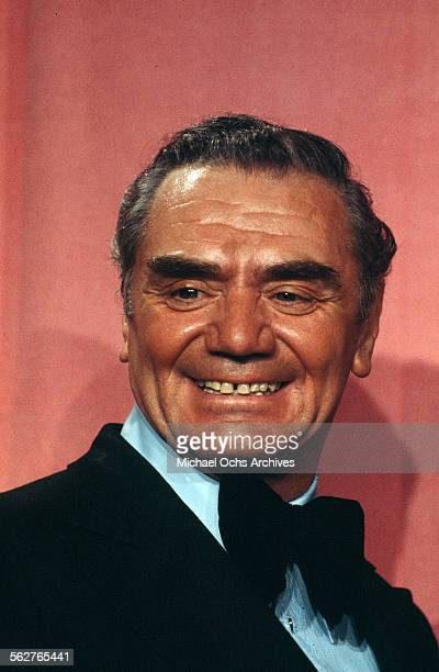 Actor Ernest Borgnine poses backstage after presenting Best Supporting Actor award during the 46th Academy Awards at Dorothy Chandler Pavilion in Los...