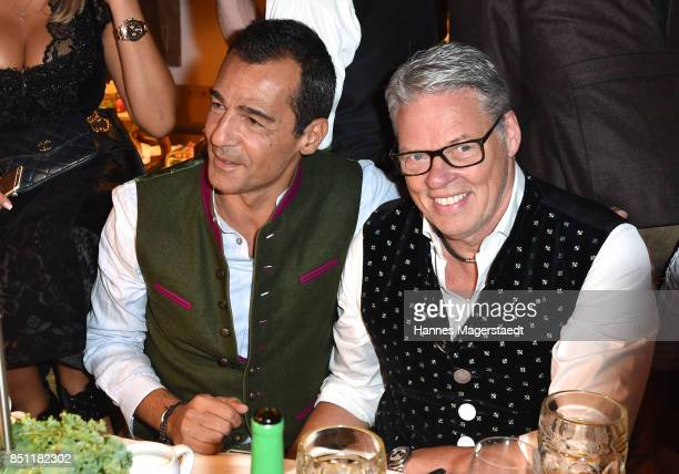Actor Erol Sander and Heiner Kamps at the Kaefer WiesnSchaenke during the Oktoberfest at Theresienwiese on September 21 2017 in Munich Germany
