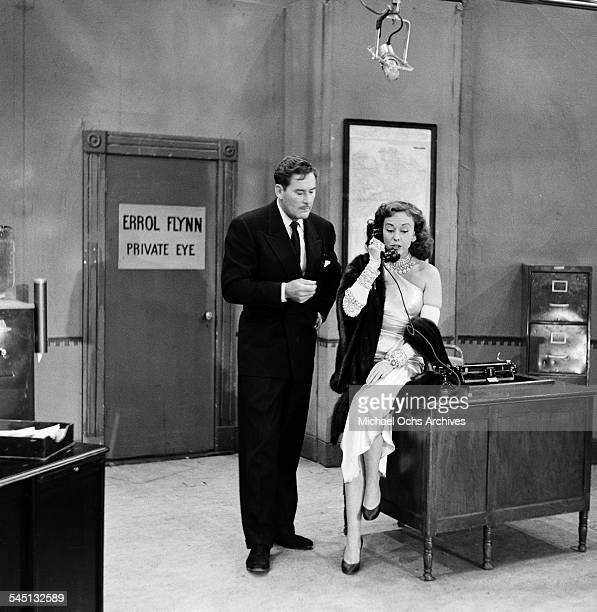 Actor Errol Flynn and actress Paulette Goddard performs on the 'Toast of the Town' show hosted by Ed Sullivan at the Maxine Elliott Theater in New...