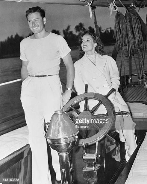 Actor Errol Flynn and his wife actress Lili Damita on their ketch Sirocco