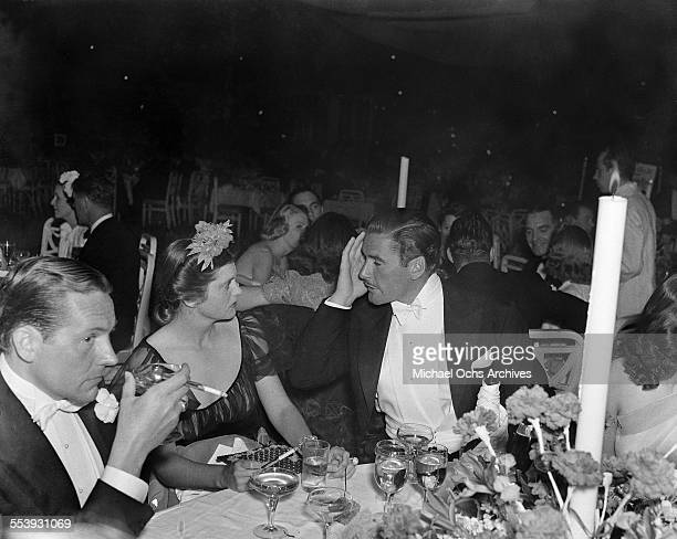 Actor Errol Flynn and wife actress Nora Eddington attend an event in Los Angeles California