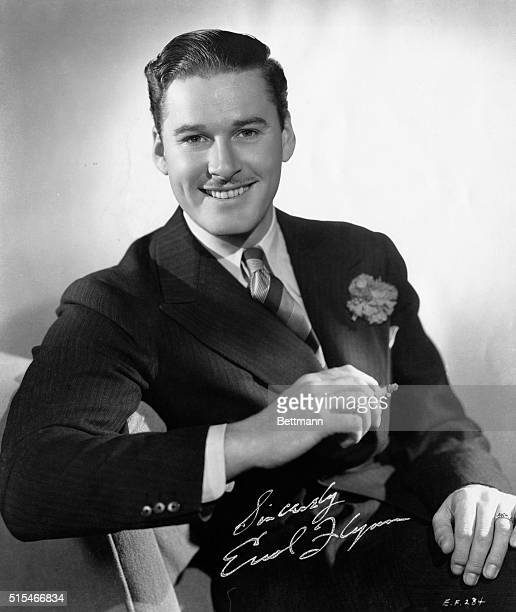 Actor Errol Flynn in an autographed publicity still from the movie Captain Blood Warner Brothers. First National Pictures Photo 1935. Actor Errol...
