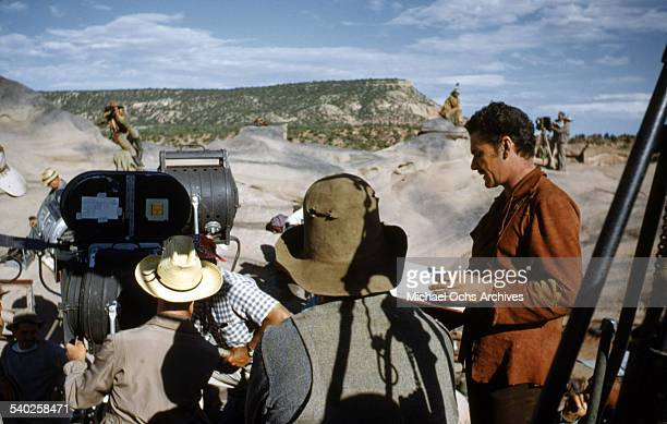 Actor Errol Flynn looks over his script as a film crew films the movie 'Rocky Mountain' on location in Gallop New Mexico Starring Errol Flynn and...