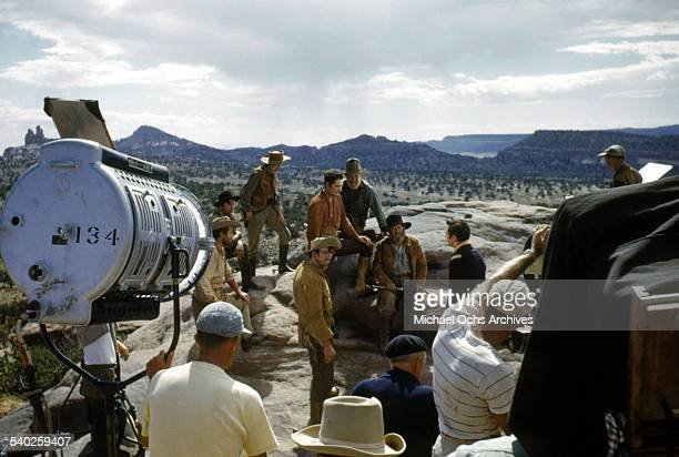 Actor Errol Flynn on set as a film crew films the movie 'Rocky Mountain' on location in Gallop New Mexico Starring Errol Flynn and Patrice Wymore